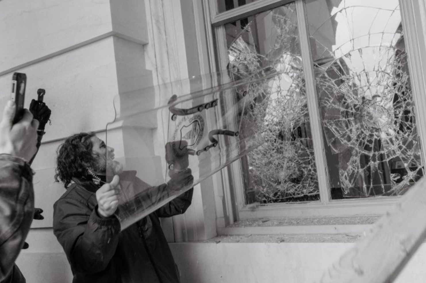 A photo of Dominic Pezzola allegedly using a riot shield to smash windows during the breach of the U.S. Capitol, as released in court documents.