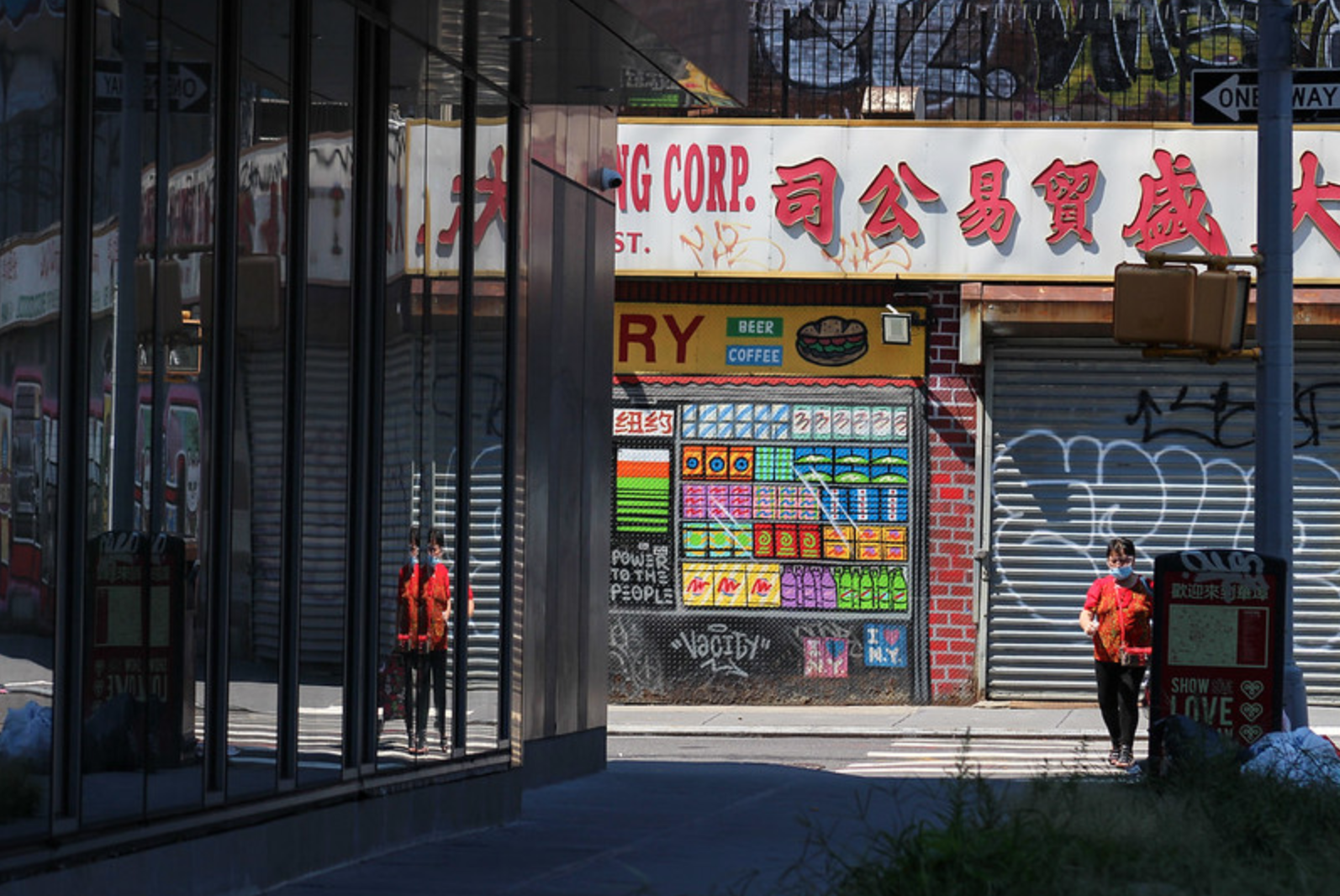 a masked woman walks through Chinatown
