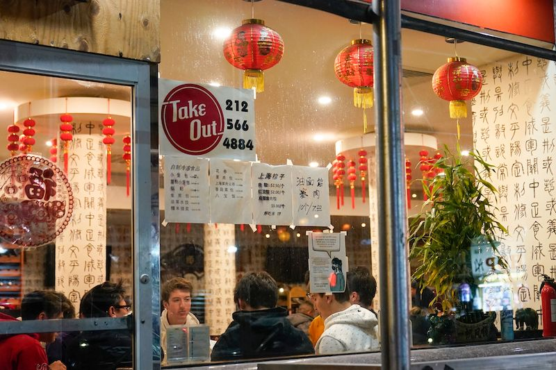 People eat inside the New Shanghai Deluxe restaurant as indoor dining resumed in Chinatown in February.