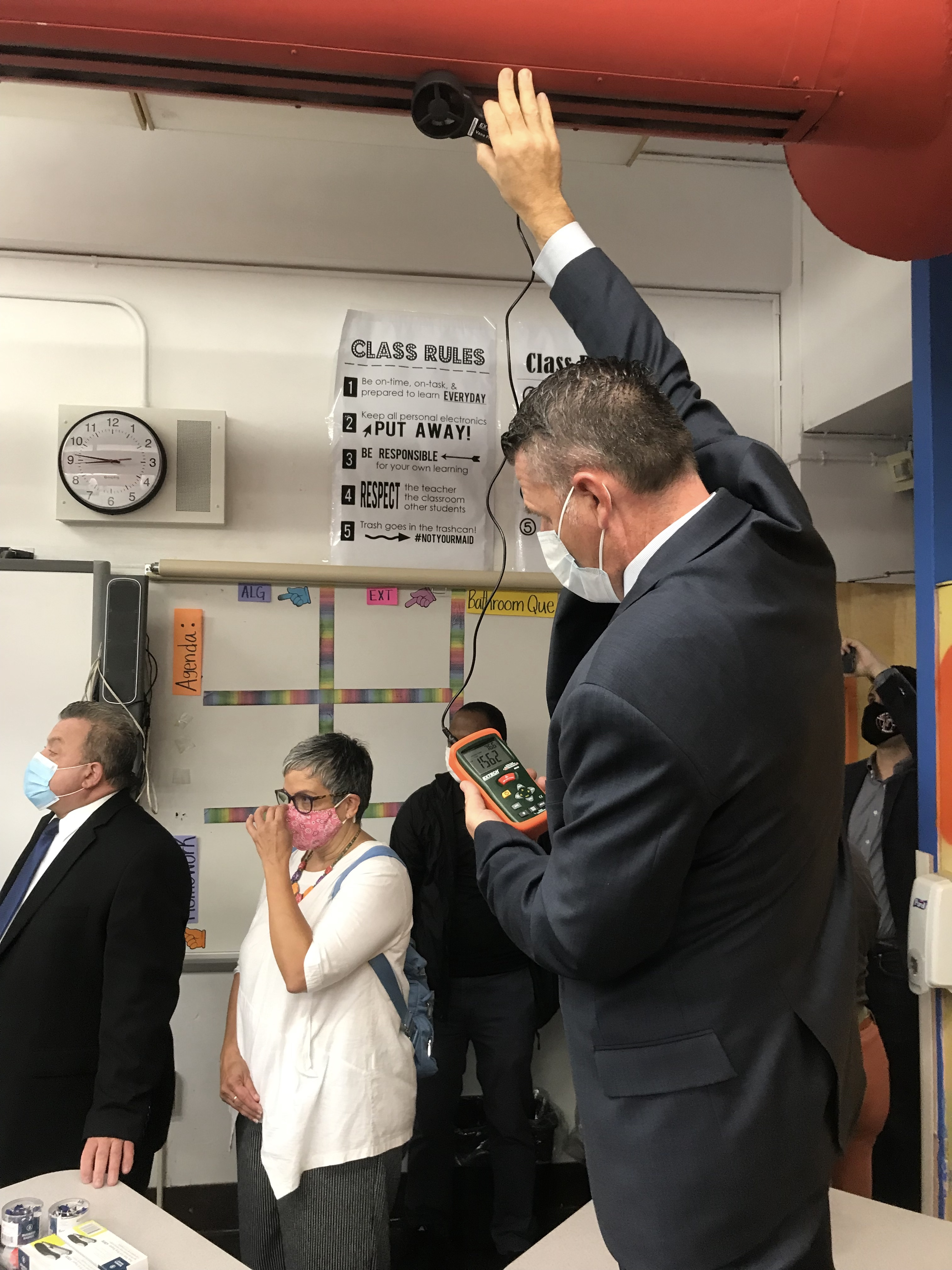 School custodian engineers will use handheld devices called anemometers to measure air flow in classrooms.