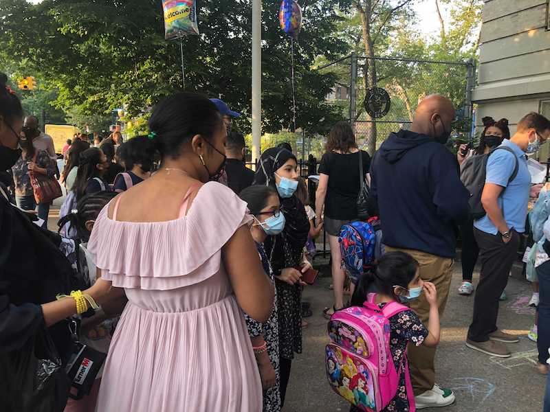 Parents and children queuing at the PS 139 in Ditmas Park on the first day of school in 2021.