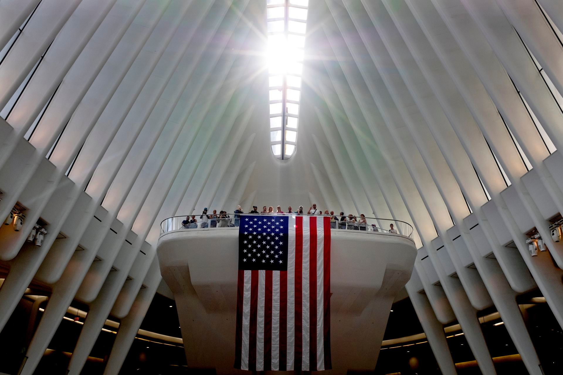 The ribbed interior of the oculus can be seen with a ray of sun shining through the center skylight