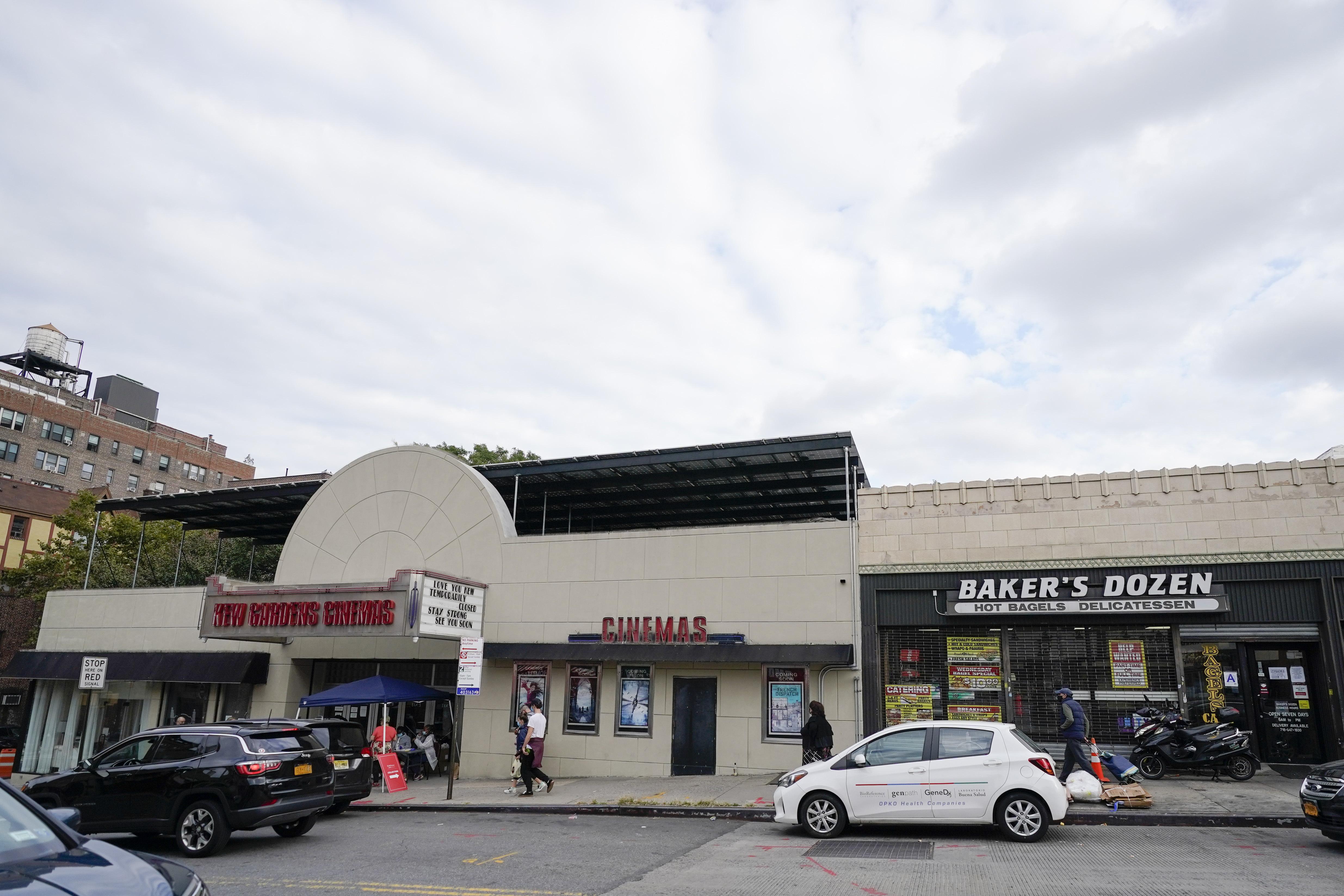 Pedestrians pass businesses on Lefferts Blvd., in Kew Gardens, Queens on October 5th, 2020.