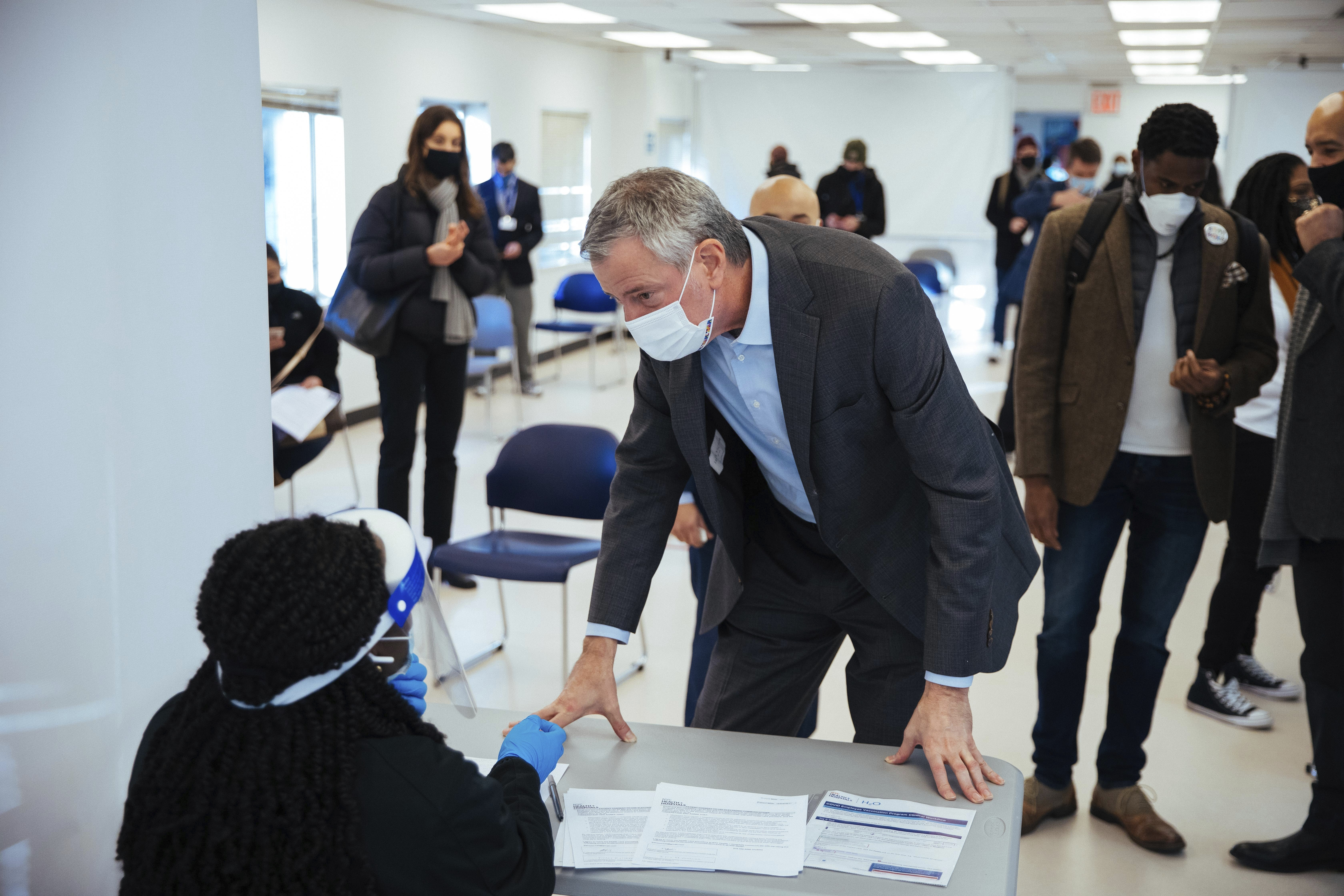 Mayor Bill de Blasio talks to staff during his visit to the Bathgate Post Office vaccination facility, in the Bronx on January 10th, 2021.