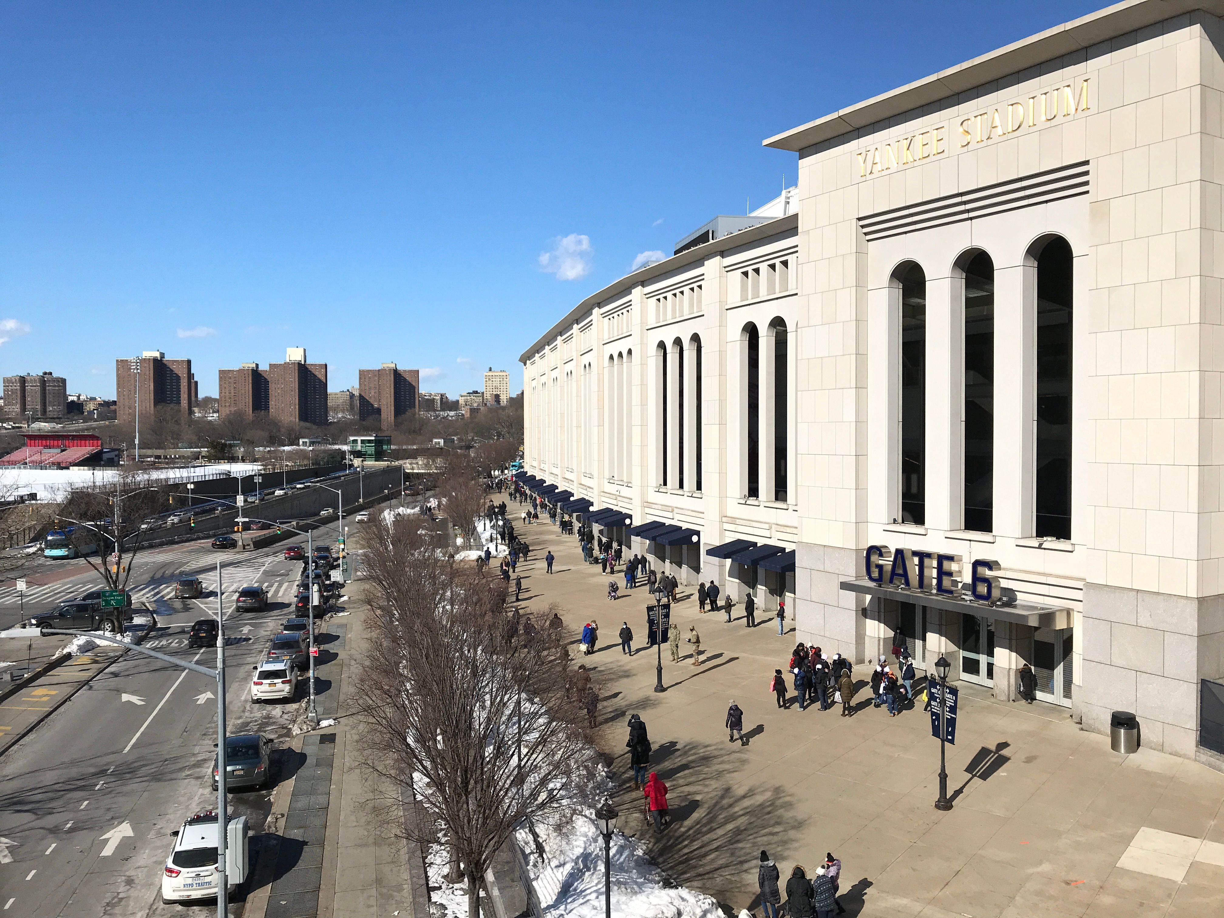 People wait in line for a COVID-19 vaccine at the Yankee Stadium vaccination site in the Bronx on February 6th, 2021.