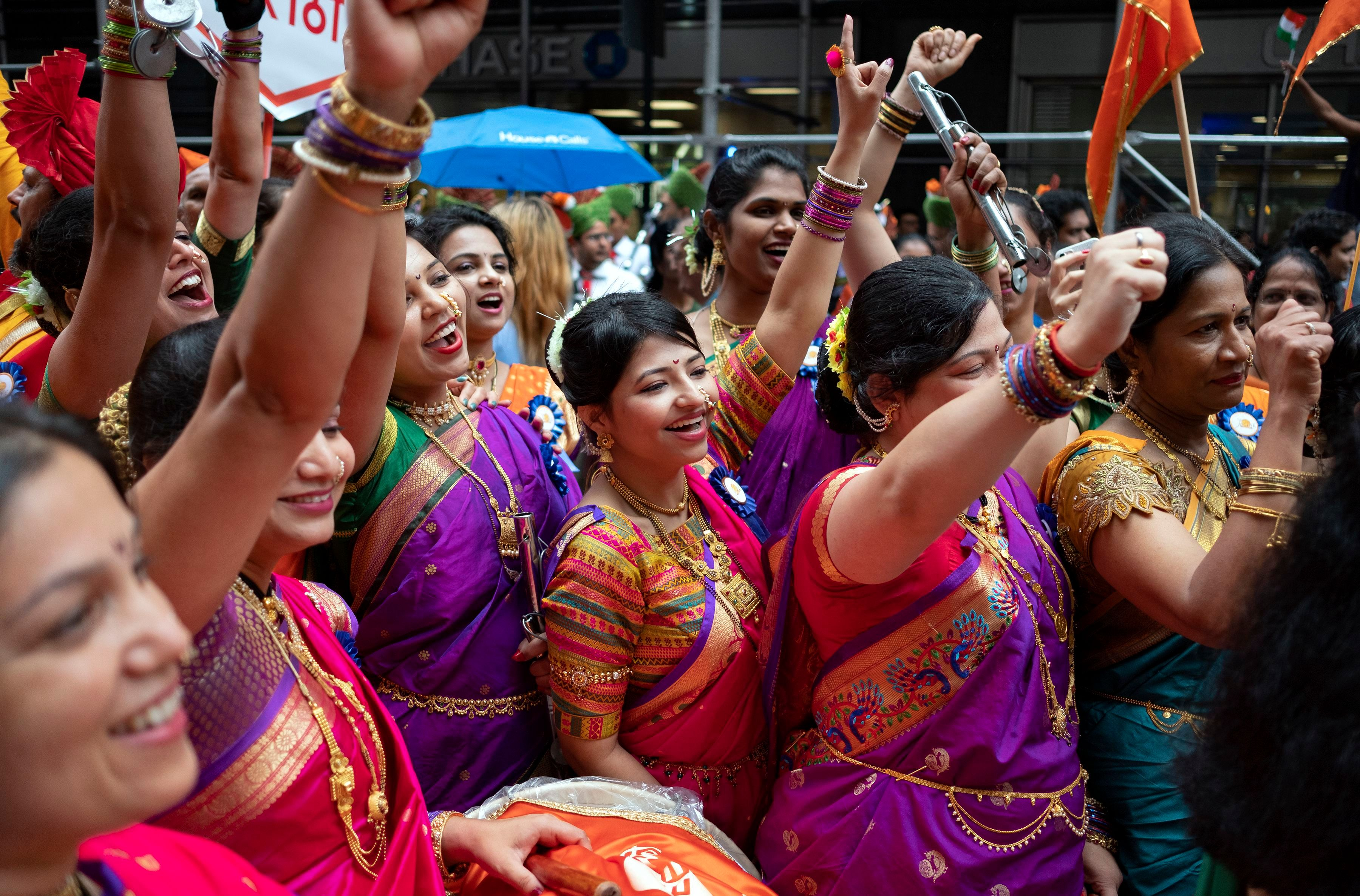 Participants in the India Day parade wearing colorful saris on Madison Avenue